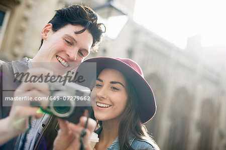 Young couple with vintage camera Stock Photo - Premium Royalty-Free, Image code: 649-07279662