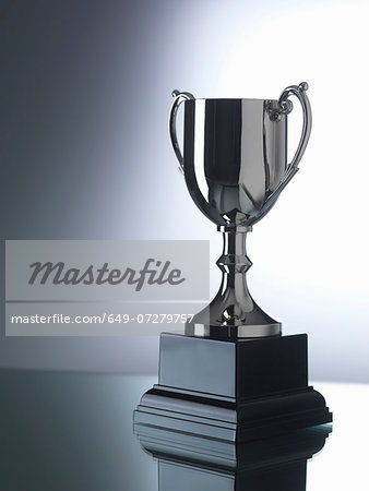 Trophy against black and white background Stock Photo - Premium Royalty-Free, Image code: 649-07279757