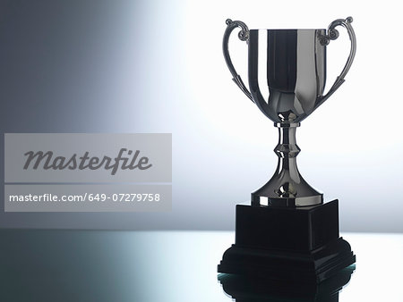 Trophy against black and white background Stock Photo - Premium Royalty-Free, Image code: 649-07279758