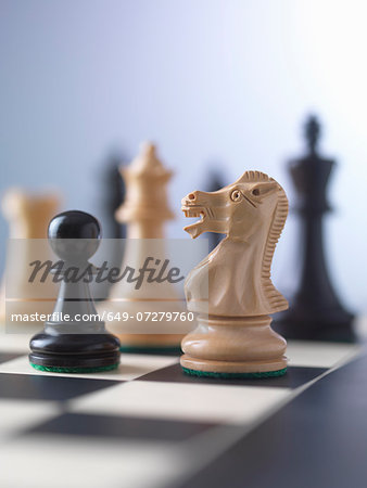 Chess game, player preparing to check mate Stock Photo - Premium Royalty-Free, Image code: 649-07279760