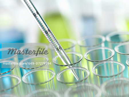 A graduated pipette being inserted into test tube Stock Photo - Premium Royalty-Free, Image code: 649-07279794