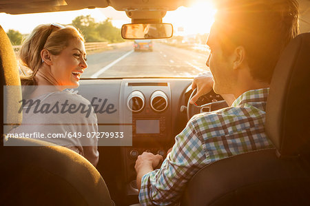 Young couple driving in car Stock Photo - Premium Royalty-Free, Image code: 649-07279933