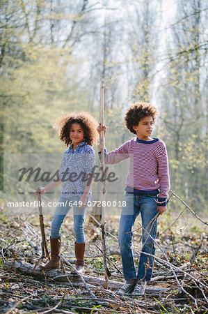 Brother and sister playing together in woods Stock Photo - Premium Royalty-Free, Image code: 649-07280018