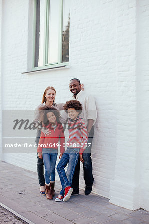 Portrait of parents and two children on sidewalk Stock Photo - Premium Royalty-Free, Image code: 649-07280037