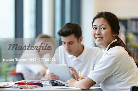 Teenagers working in school classroom Stock Photo - Premium Royalty-Free, Image code: 649-07280078