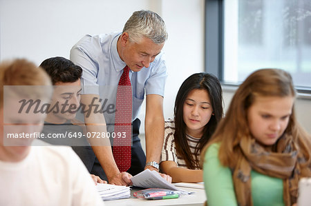 Teacher working with teenagers in classroom Stock Photo - Premium Royalty-Free, Image code: 649-07280093