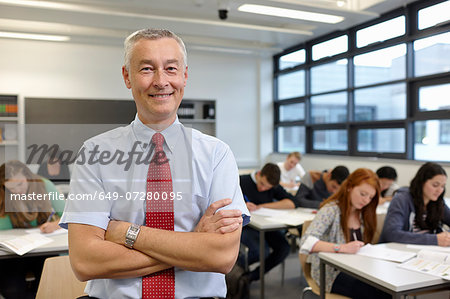 Portrait of mature male teacher in classroom Stock Photo - Premium Royalty-Free, Image code: 649-07280095