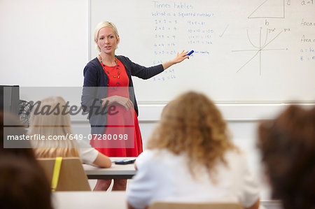 Female teacher using white board in front of class Stock Photo - Premium Royalty-Free, Image code: 649-07280098