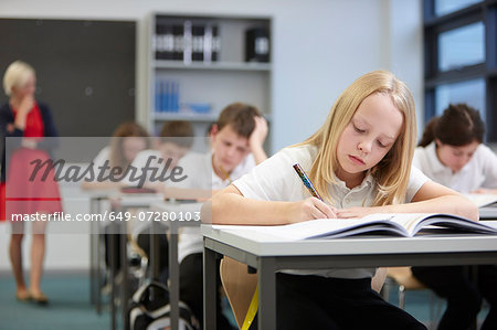 Female teacher watching class doing educational exam Stock Photo - Premium Royalty-Free, Image code: 649-07280103