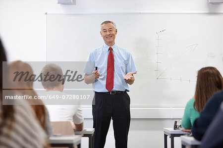 Mature male teacher in front of class Stock Photo - Premium Royalty-Free, Image code: 649-07280107