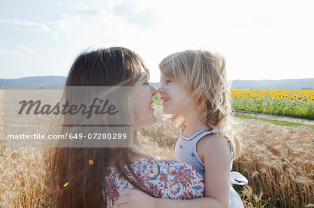 Mother and daughter in wheat field hugging Stock Photo - Premium Royalty-Free, Image code: 649-07280289