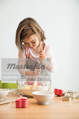 Girl mixing batter in bowl Stock Photo - Premium Royalty-Free, Image code: 649-07280350