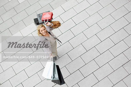 Portrait of mid adult woman with abundance of shopping bags Stock Photo - Premium Royalty-Free, Image code: 649-07280419