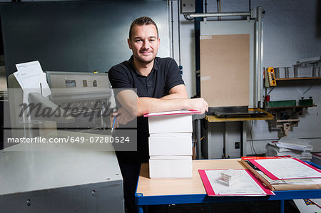 Portrait of worker in paper printing workshop Stock Photo - Premium Royalty-Free, Image code: 649-07280524