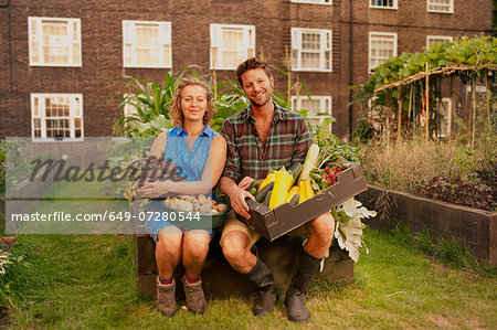 Couple holding harvested vegetables on council estate allotment Stock Photo - Premium Royalty-Free, Image code: 649-07280544