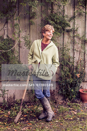 Portrait of mature woman leaning on spade in garden Stock Photo - Premium Royalty-Free, Image code: 649-07280589