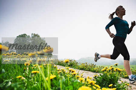 Mature woman running in countryside Stock Photo - Premium Royalty-Free, Image code: 649-07280681