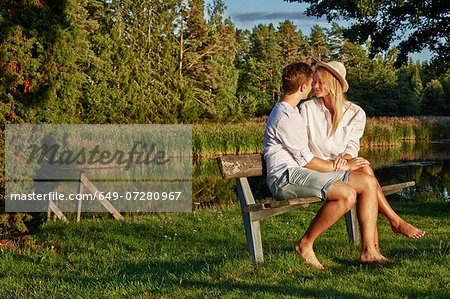 Romantic young couple on park bench, Gavle, Sweden Stock Photo - Premium Royalty-Free, Image code: 649-07280967