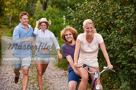 Two young couples chasing each other on bicycle, Gavle, Sweden Stock Photo - Premium Royalty-Free, Image code: 649-07280970