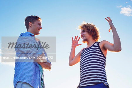 Two male friends enjoying conversation in sunlight Stock Photo - Premium Royalty-Free, Image code: 649-07280973