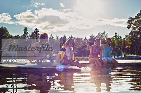 Two young couples relaxing on pier, Gavle, Sweden Stock Photo - Premium Royalty-Free, Image code: 649-07280981