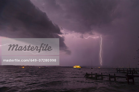 View of storm and lightning on Lake Starnberg, Bavaria, Germany Stock Photo - Premium Royalty-Free, Image code: 649-07280998