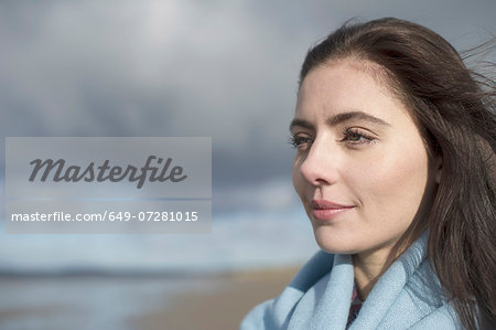 Young woman looking at view Stock Photo - Premium Royalty-Free, Image code: 649-07281015