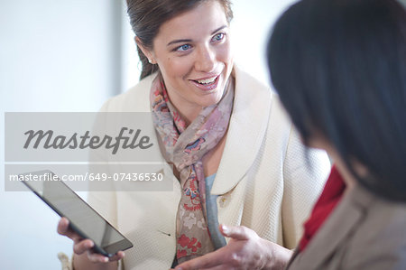 Businesswomen using digital tablet Stock Photo - Premium Royalty-Free, Image code: 649-07436530
