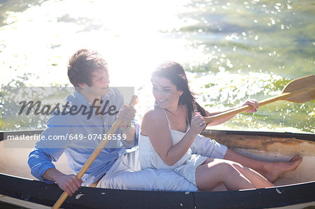 Young couple in rowing boat on river in sunlight Stock Photo - Premium Royalty-Free, Image code: 649-07436559