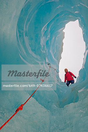 Ice climber looking down ice cave Fox Glacier, South Island, New Zealand Stock Photo - Premium Royalty-Free, Image code: 649-07436617
