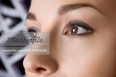 Close up studio portrait of young woman's eyes Stock Photo - Premium Royalty-Free, Image code: 649-07436630