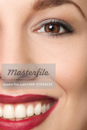 Cropped studio portrait of young woman smiling Stock Photo - Premium Royalty-Free, Image code: 649-07436635