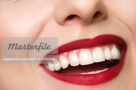 Cropped studio portrait of young woman's smiling mouth Stock Photo - Premium Royalty-Free, Image code: 649-07436638