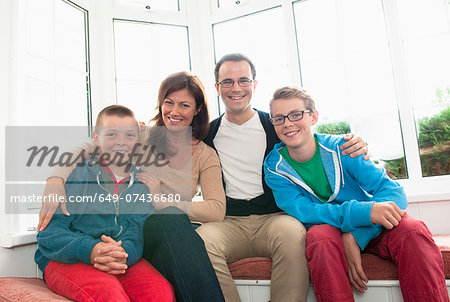 Family portrait in front of window Stock Photo - Premium Royalty-Free, Image code: 649-07436680