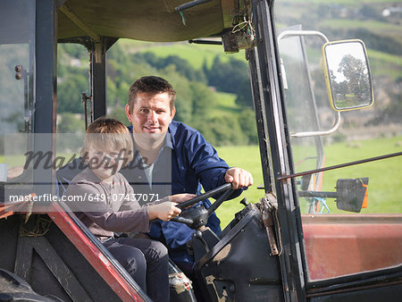 Farmer and young son in tractor in field, portrait Stock Photo - Premium Royalty-Free, Image code: 649-07437071