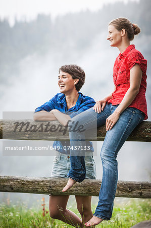 Two female friends looking at view, Tyrol Austria Stock Photo - Premium Royalty-Free, Image code: 649-07437133