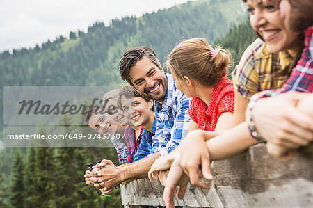 Group of friends leaning on wooden fence, Tirol, Austria Stock Photo - Premium Royalty-Free, Image code: 649-07437307