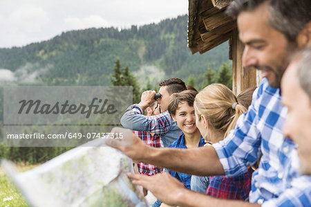 Group of friends chatting and reading map, Tirol, Austria Stock Photo - Premium Royalty-Free, Image code: 649-07437315