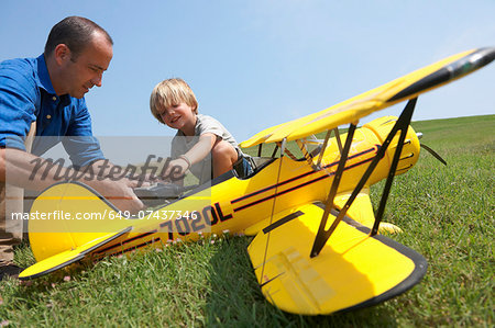 Father and son preparing model plane Stock Photo - Premium Royalty-Free, Image code: 649-07437346