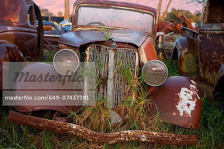 Close up of vintage car in scrap yard Stock Photo - Premium Royalty-Free, Image code: 649-07437391