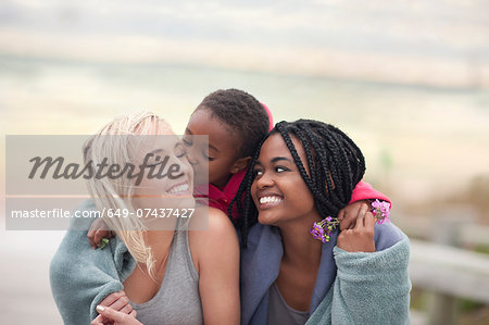 Portrait of gay couple with child Stock Photo - Premium Royalty-Free, Image code: 649-07437427