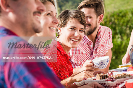 Group of friends sitting for breakfast outdoors Stock Photo - Premium Royalty-Free, Image code: 649-07437521