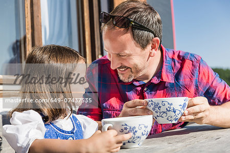 Close up portrait of father and daughter outside chalet, Tyrol, Austria Stock Photo - Premium Royalty-Free, Image code: 649-07437535