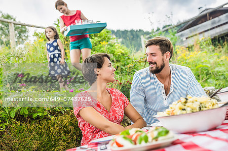 Young couple sharing picnic lunch, Tyrol, Austria Stock Photo - Premium Royalty-Free, Image code: 649-07437625