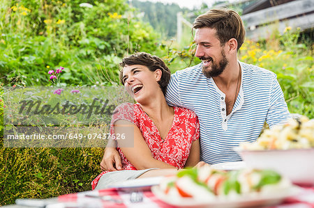 Young couple having picnic lunch, Tyrol, Austria Stock Photo - Premium Royalty-Free, Image code: 649-07437626