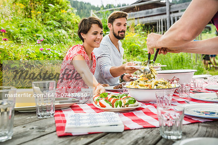 Group of friends sharing picnic lunch, Tyrol, Austria Stock Photo - Premium Royalty-Free, Image code: 649-07437630