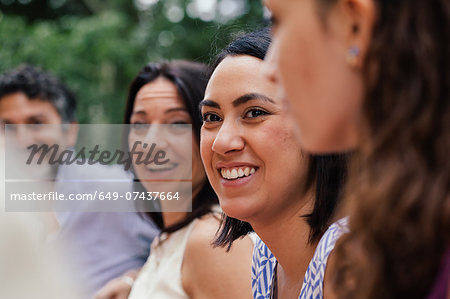 Young woman amongst family members Stock Photo - Premium Royalty-Free, Image code: 649-07437664