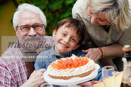 Boy with birthday cake from grandparents Stock Photo - Premium Royalty-Free, Image code: 649-07437672