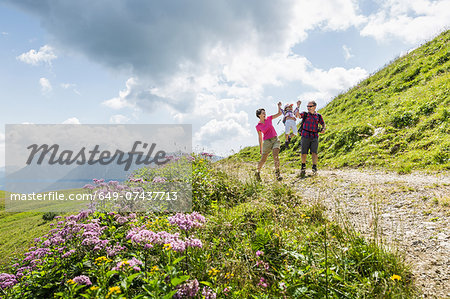 Parents and daughter having fun on walk, Tyrol, Austria Stock Photo - Premium Royalty-Free, Image code: 649-07437713