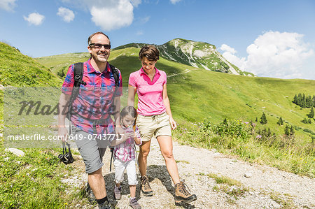 Parents and daughter walking on mountain track, Tyrol, Austria Stock Photo - Premium Royalty-Free, Image code: 649-07437717